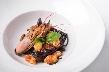 spaghetti with cuttlefish ink and langoustines