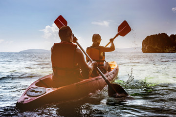 Man and woman kayaking in sea