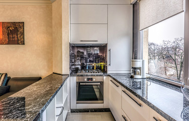 Contemporary modern black colored kitchen with fitted appliances and breakfast bar, chisinau, moldova