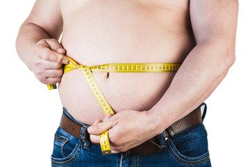 Thick mature man measuring his belly with a measuring tape, isolated on white background. Not proper nutrition.