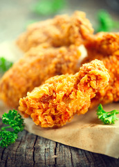 Crispy fried kentucky chicken wings on wooden table