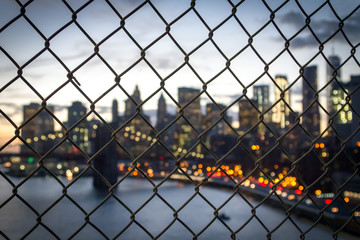 New York City Skyline Nights Lights Seen Through Chain Linked Fence