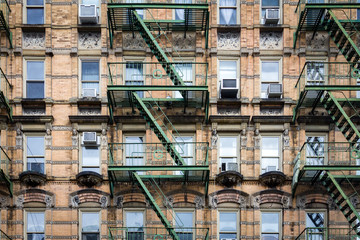 Windows and Fire Escape on Old Building in New York City