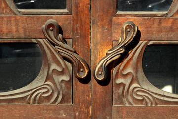 Old door with carved wooden handles