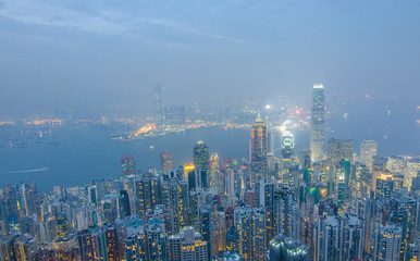 Hong Kong the scenes, victoria harbour from the peak bird view, in the mist with bad weather in the night, nimbus landscape on the trails