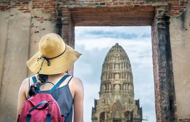 Girl exploring ancient Ayutthaya city in Thailand