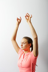 Young healthy yoga woman practicing yoga with closed eyes