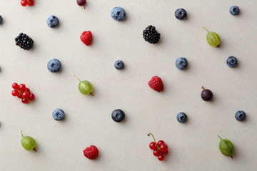 Summer berry on concrete background