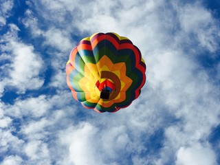 Low Angle View Of Colorful Hot Air Balloon Against Cloudy Sky
