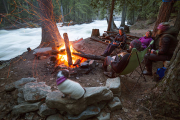 Campers enjoy their campfire in the twilight.