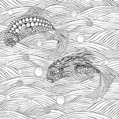 Two fantastic fish swim in the sea bottom.