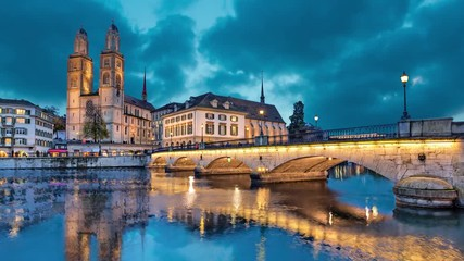 Fotomurales - Munsterbrucke and Grossmunster church reflecting in river Limmat, Zurich, Switzerland (static image with animated sky)