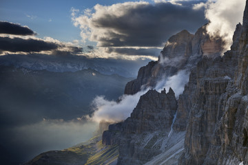 Bocca di Brenta, Brenta dolomites, Adamello Brenta natural park, Trentino, Italy. Clouds into the valley at sunset.