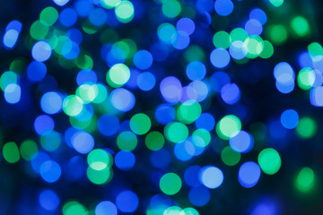 Blurred lights blue background. Glittering christmas effect. Abstract colorful pattern. Shimmering blur spots. Festive design.