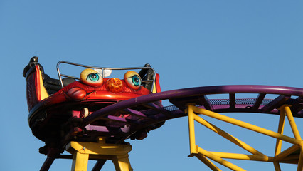 An Amusement Fun Fair Ride on a Bright Sunny Day.