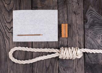 A rope for hanging and a suicide note on an old wooden table,Loop lynch, soap