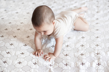 A cute newborn trying to crawl