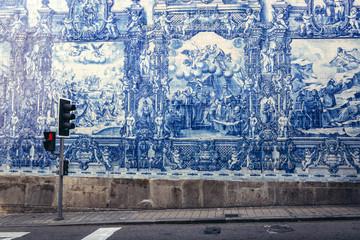 Characteristic tilework called Azulejo on Capela das Almas church in Porto, Portugal