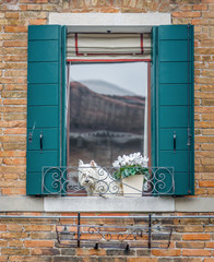 Beautiful window on the ancient wall - Venice, Italy