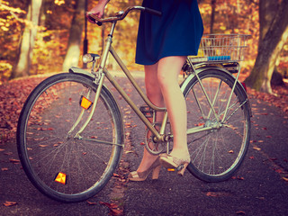 Lady cycling in park.