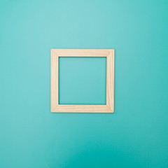 Wooden frame on a colored background