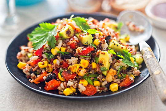 Mexican rice, quinoa avocado salad with chilli dressing