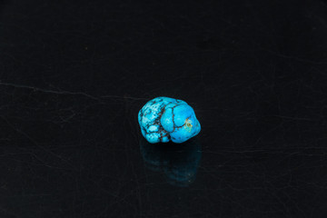 turquoise on black background from personal collection of Semi-precious stones and minerals