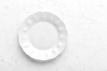 Empty white plate on white background top view copy space