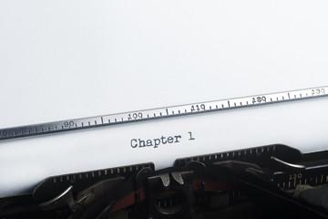 Chapter One typed. Vintage typewriter. Copyspace.