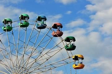 Ferris wheel in the summer Park