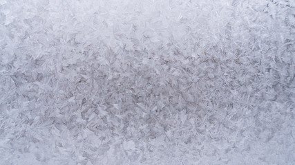 a picture of frost on the glass. Subzero temperatures on the street. Frozen crystals of water on the glass