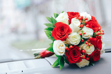 .Wedding bouquet in the hands of the bride