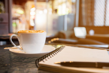 Cup of cappuccino in coffee ship
