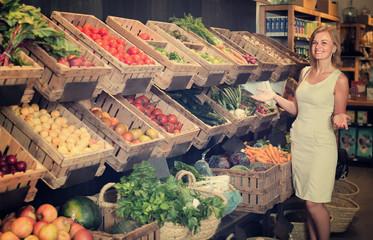 female customer choosing vegetables and fruits.