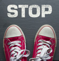 red sneakers with stop sign