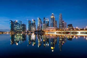 Singapore business district skyline in night at Marina Bay, Singapore.
