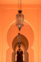 orange corridor walkway with the shadow from tree