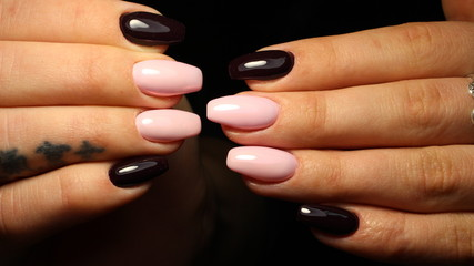 Manicure design is light pink and black