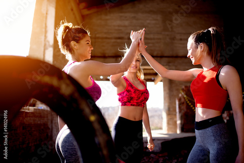 After workout girls clapping hands smiling positive energy