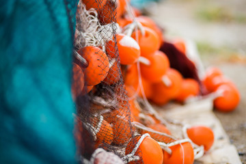 Fishing nets and orange floats close-up.