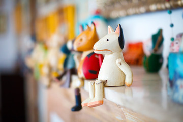toy white wooden horse sits on a mantelpiece before other homemade toys