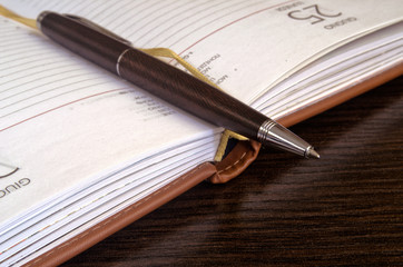 Close up of a pen and notebook.