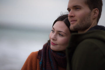 Young adult couple on winter beach