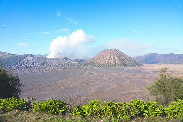 Mount Bromo, an active volcano with clear bly sky at the Tengger Semeru National Park in East Java, Indonesia.