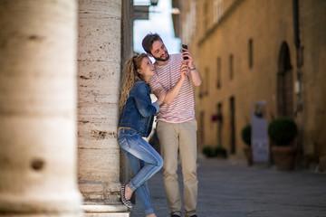 Tourists taking a photo of landmark