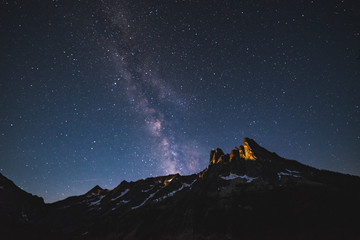 View of mountain peak against starry sky at night sky