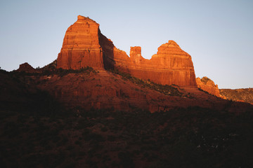 View of rock formation peak at sunset