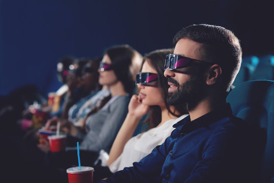 Side view of couple in 3d glasses watching movie.