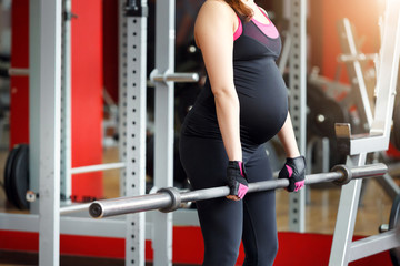 Pregnant woman exercising in the gym