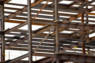 Multi-story steel frame commercial building under construction.